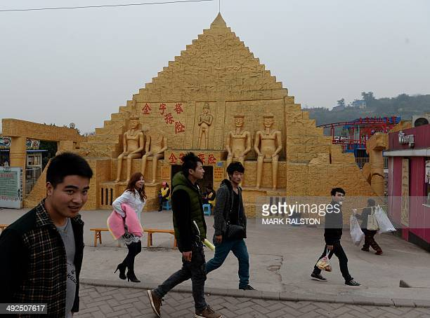 ChinaculturearchitecturetradeoffbeatFEATURE by Carol Huang This photo taken on on February 21 2014 shows a copy of a pyramid at a theme park in...