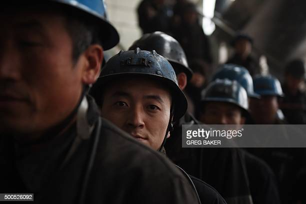 ChinaeconomyenvironmentcoalclimateFOCUS by Tom HANCOCK In this photo taken on November 19 miners wait to enter the Tashan coal mine near Datong in...