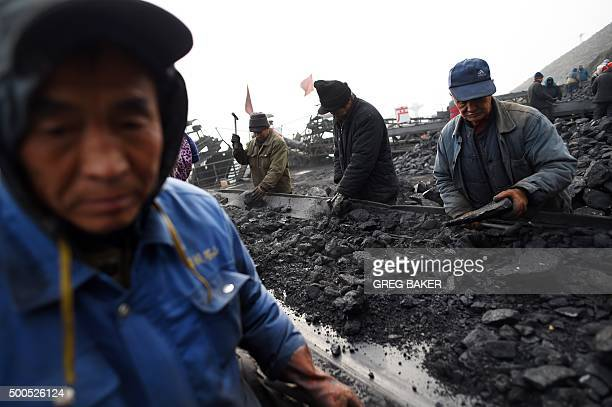 ChinaeconomyenvironmentcoalclimateFOCUS by Tom HANCOCK In this photo taken on November 20 workers sort coal on a conveyer belt near a coal mine at...