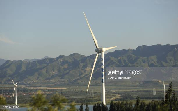 ChinaeconomyenvironmentenergytradeFOCUS by Allison Jackson This picture taken on August 25 2010 shows a windfarm on the outskirts of Beijing China...