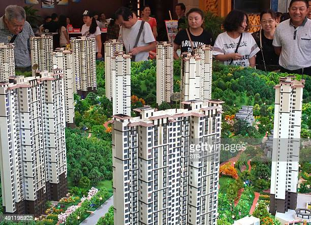 ChinaeconomyGDPFOCUS by Julien Girault This photo taken on October 1 2015 shows Chinese home buyers visiting a housing fair in Yichang in China's...