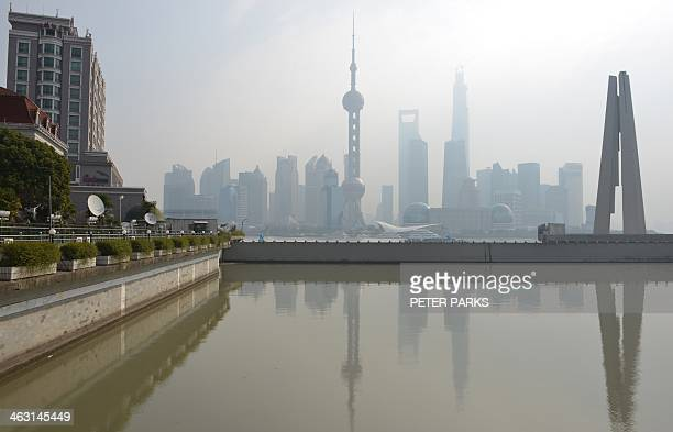 ChinaeconomygrowthADVANCER by Kelly OLSEN This general view shows the financial district of Pudong over the Huangpu river in Shanghai on January 17...