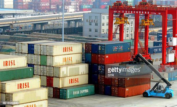 ChinaeconomygrowthGDP by Kelly Olsen This picture taken on January 17 2015 shows a vehicle preparing to lift a container at the port in Lianyungang...