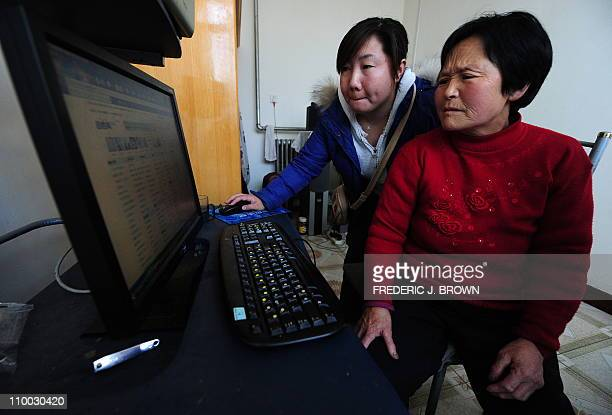 ChinaeconomyInternetfarm FEATURE by Allison JacksonIn a picture taken on March 9 2011 farmer Wang Yulan goes online with the help of her neice Liu...