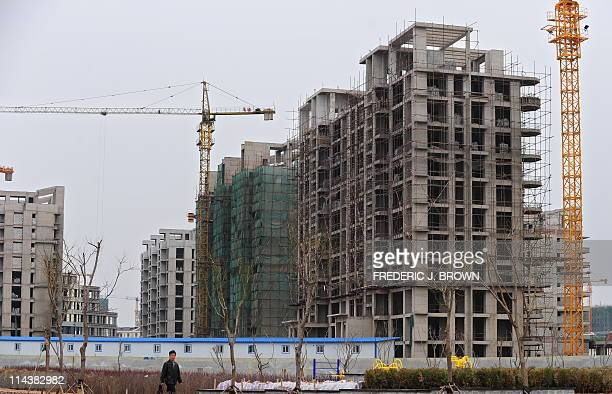 STORY 'ChinaeconomysocietypropertyFEATURE' by Allison JacksonA construction site stands in Kangbashi a district on the outskirts of Ordos in China's...