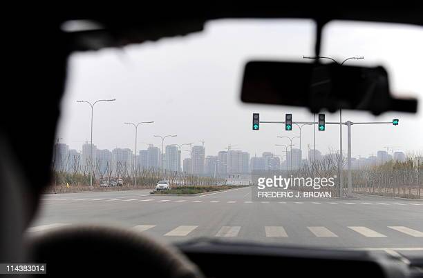 STORY 'ChinaeconomysocietypropertyFEATURE' by Allison JacksonA driver approaches an intersection in Kangbashi a district on the outskirts of Ordos in...
