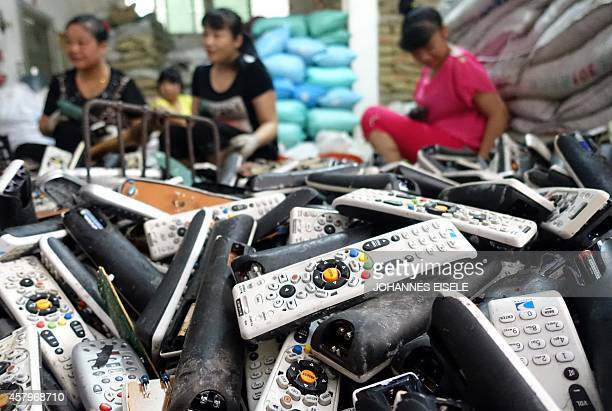 ChinaeconomytechnologyenvironmentlifestylenewseriesFEATURE by Felicia SONMEZ This photo taken on August 9 2014 shows workers dismantling electronic...