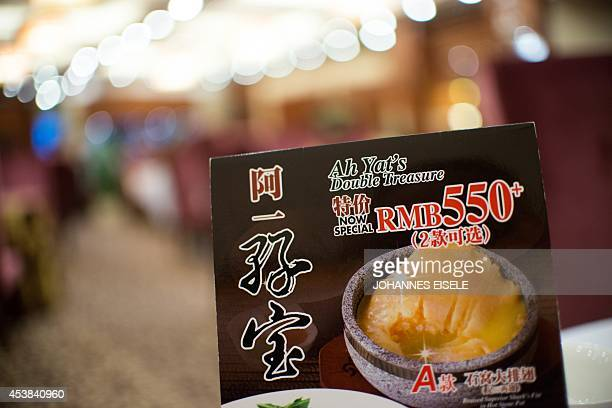 ChinaenvironmentsocialfoodeconomyFOCUS by Felicia SONMEZ This photo taken on August 10 2014 shows an advertisement for shark fin soup at a restaurant...