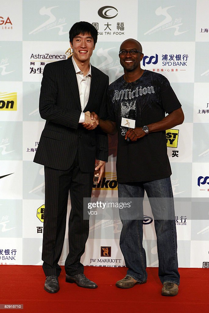 Chinaese 110 meters hurdler Liu Xiang (L) and Allen Johnson attend a party for the players who will attend the Shanghai Golden Grand Prix on September 19, 2008 in Shanghai, China.