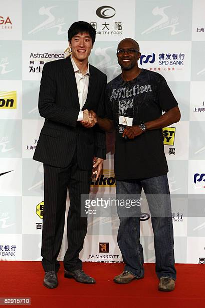 Chinaese 110 meters hurdler Liu Xiang and Allen Johnson attend a party for the players who will attend the Shanghai Golden Grand Prix on September 19...
