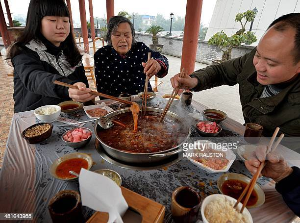 ChinafoodculturelifestyleFEATURE by Carol Huang This photo taken on February 22 2014 shows workers enjoying hot pot food at a hot pot museum and...
