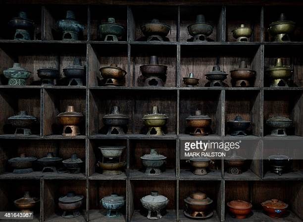 ChinafoodculturelifestyleFEATURE by Carol Huang This photo taken on February 22 2014 shows antique hot pots at a hot pot museum and factory in...