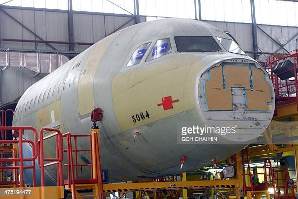 ChinaFranceEUaviationAirbusFOCUS by Julien GIRAULT This picture taken on February 24 2014 shows an Airbus A320 fuselage being assembled at the Airbus...