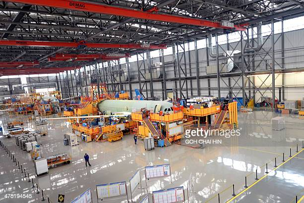 ChinaFranceEUaviationAirbusFOCUS by Julien GIRAULT This picture taken on February 24 2014 shows an Airbus A320 being assembled at the Airbus assembly...