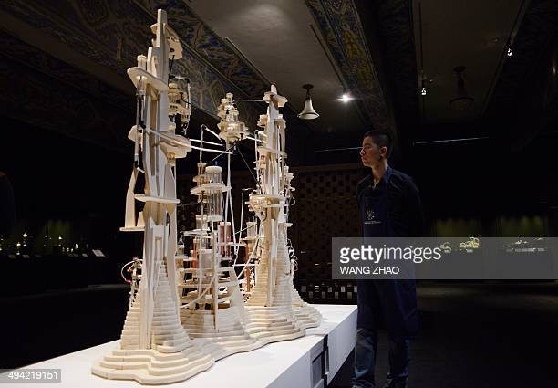 ChinaFrancewinehistorycultureFEATURE by Sebastien Blanc This picture taken on May 16 2014 shows a man looking at the wine and tea 'Alembic' at the...