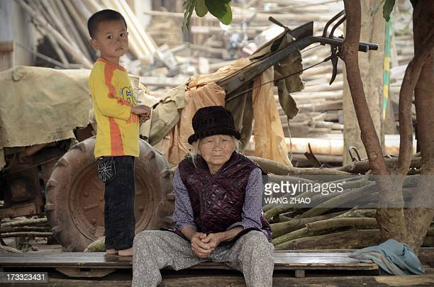 ChinahealthpeopleageingsocialFEATURE This picture taken on January 22 2013 shows an elderly woman looking on as she having a rest with a boy by a...