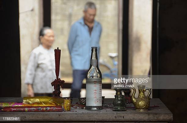 ChinahealthpeopleageingsocialFEATURE This picture taken on January 22 2013 shows an altar in the house of Liu Yuhua one hundred and five year old...
