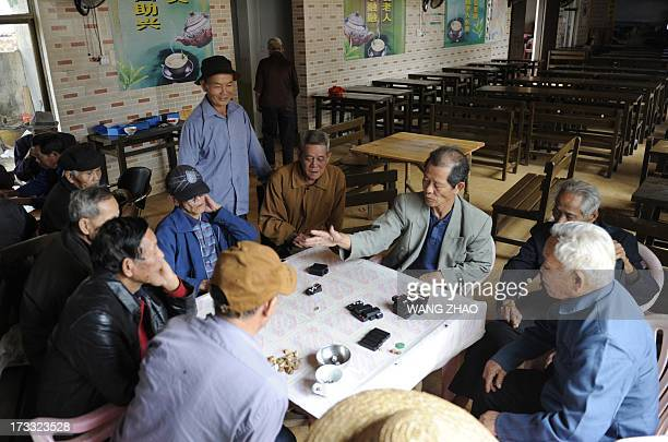 ChinahealthpeopleageingsocialFEATURE This picture taken on January 22 2013 shows a group of elderly men playing at a tea house in Chengmai city in...