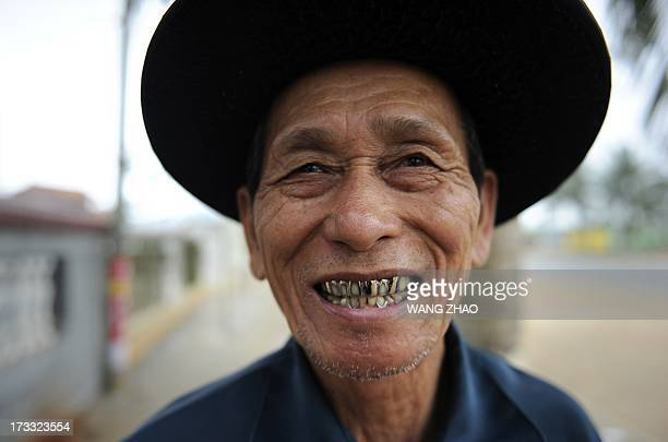 ChinahealthpeopleageingsocialFEATURE This picture taken on January 22 2013 shows an elderly man laughing outside at a tea house in Chengmai city in...