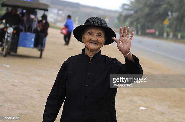 ChinahealthpeopleageingsocialFEATURE This picture taken on January 22 2013 shows an elderly woman waving her hand in Chengmai city in China's...
