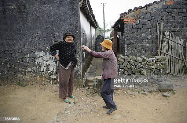 ChinahealthpeopleageingsocialFEATURE This picture taken on January 22 2013 shows an elderly woman Hu Aihe talking with her sisterinlaw in Chengmai...