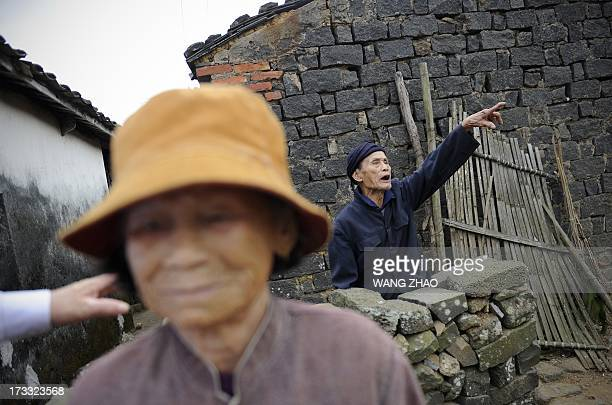 ChinahealthpeopleageingsocialFEATURE This picture taken on January 22 2013 shows an elderly man Wang kaiguo gesturing in Chengmai city in China's...