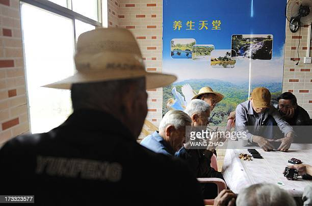 ChinahealthpeopleageingsocialFEATURE This picture taken on January 22 2013 shows a group of elderly men playing on at a tea house in Chengmai city in...
