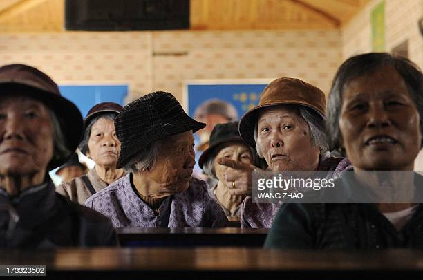 ChinahealthpeopleagingsocialFEATURE This picture taken on January 22 2013 shows two elderly women chating at a tea house in Chengmai city in China's...