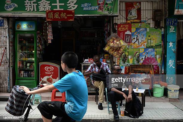 ChinaHongKongAfricaEconomyTradeFEATURE by Rhia Tejpe In a picture taken on August 26 traders from Africa rest outside a convenience store in...