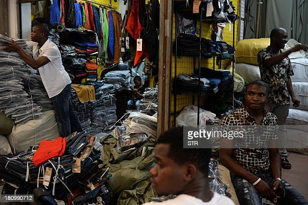 ChinaHongKongAfricaEconomyTradeFEATURE by Rhia Tejpe In a picture taken on August 26 Lamine Ibrahim from Guinea works as his fouryearold son looks on...