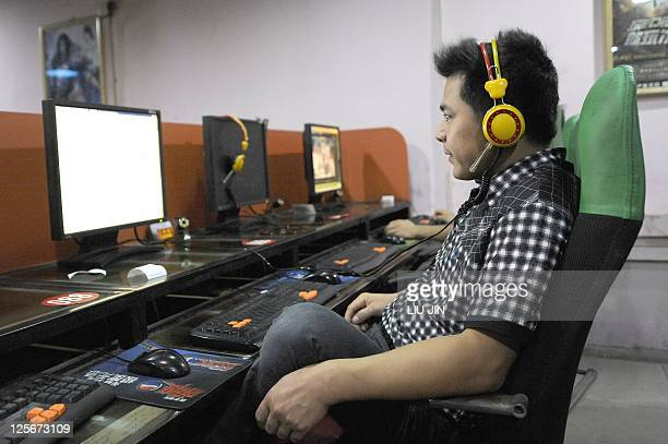 ChinaInternetmediaANALYSIS by Jonathan Landreth A man browses websites at an Internet bar in Beijing on September 8 2011 Beijing has moved to stem a...