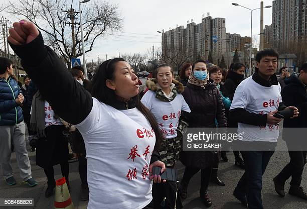 ChinainvestmentInternetFOCUS by Bill Savadove This photo taken on February 4 2016 shows investors in Chinese online peertopeer lender Ezubao chanting...