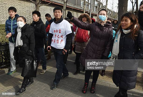 ChinainvestmentInternetFOCUS by Bill Savadove This photo taken on February 4 2016 shows investors in Chinese online peertopeer lender Ezubao gathered...