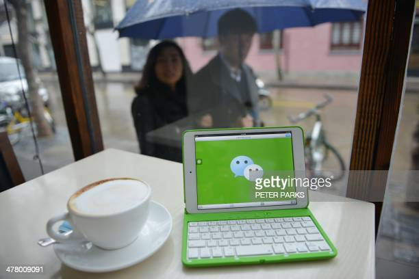 ChinaITtelecommunicationTencentFOCUS This photo illustration taken on March 12 2014 shows the logo of Chinese instant messaging platform called...
