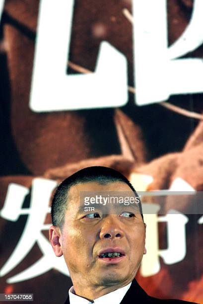 ChinaJapanhistoryfilmFOCUS by Sebastien Blanc This picture taken on November 25 2012 shows Chinese film director Feng Xiaogang at the press...