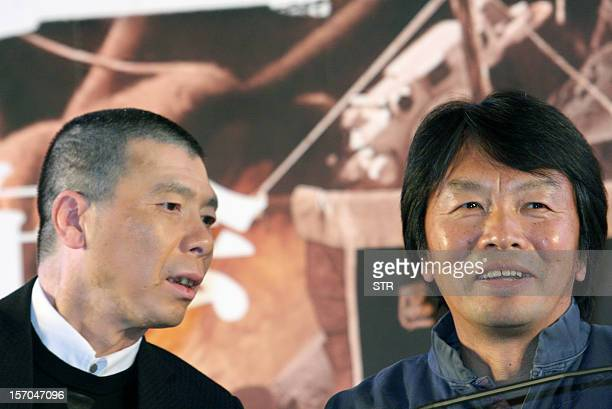 ChinaJapanhistoryfilmFOCUS by Sebastien Blanc This picture taken on November 25 2012 shows Chinese film director Feng Xiaogang talking to...
