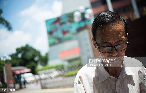 ChinalanguagepoliticsGuangdongFEATURE by Felicia SONMEZ This photo taken on August 11 2014 shows Zhang Yiyi a professor of French in front of the...