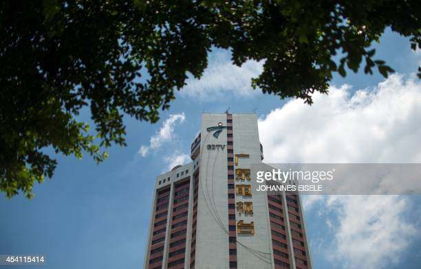 ChinalanguagepoliticsGuangdongFEATURE by Felicia SONMEZ This photo taken on August 11 2014 shows the headquarters building of GDTV Guangdong...