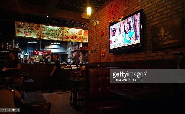 ChinalanguagepoliticsGuangdongFEATURE by Felicia SONMEZ This photo taken on August 11 2014 shows a the GDTV Guangdong Television being shown in a...