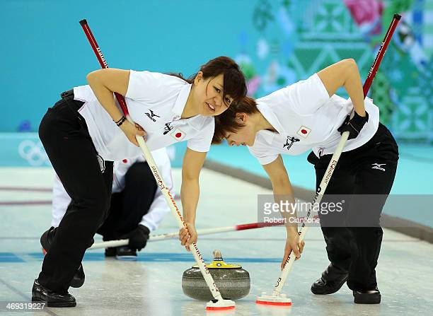 Chinami Yoshida and Michiko Tomabechi follow the stone during the Curling Women's Round Robin match between Japan and Great Britain on day seven of...