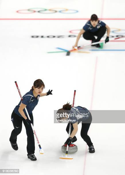 Chinami Yoshida and Yumi Suzuki of Japan sweep against the united States of America during Women's Round Robin Session 1 on day five of the...