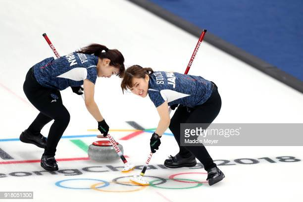 Chinami Yoshida and Yumi Suzuki of Japan sweep the ice against the United States of America during Women's Round Robin Session 1 on day five of the...