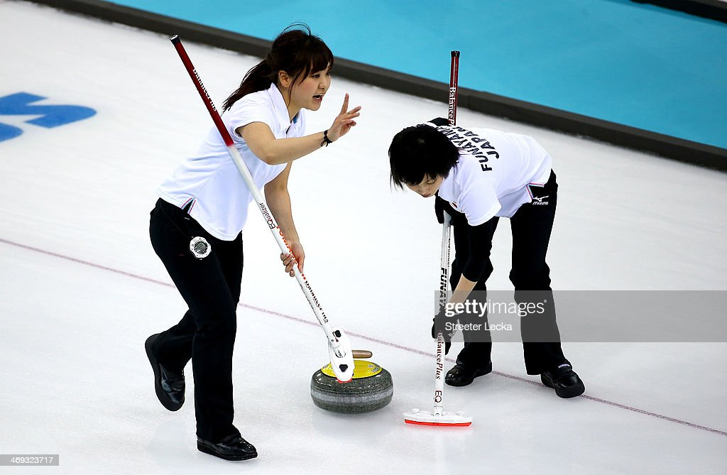 Chinami Yoshida and Yumie Funayama of Japan compete against Great Britain during the Women's Curling Round Robin match on day seven of the Sochi 2014 Winter Olympics at Ice Cube Curling Center on February 14, 2014 in Sochi, Russia.