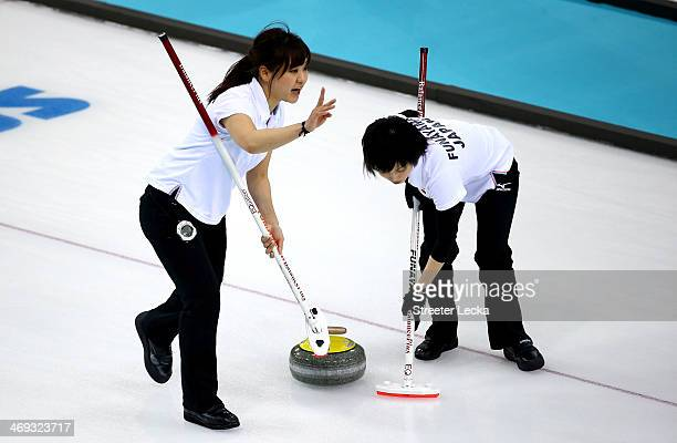Chinami Yoshida and Yumie Funayama of Japan compete against Great Britain during the Women's Curling Round Robin match on day seven of the Sochi 2014...
