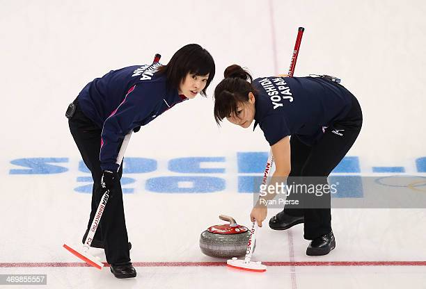 Chinami Yoshida and Yumie Funayama of Japan compete during the in action during Curling Women's Round Robin match between Japan and China on day ten...