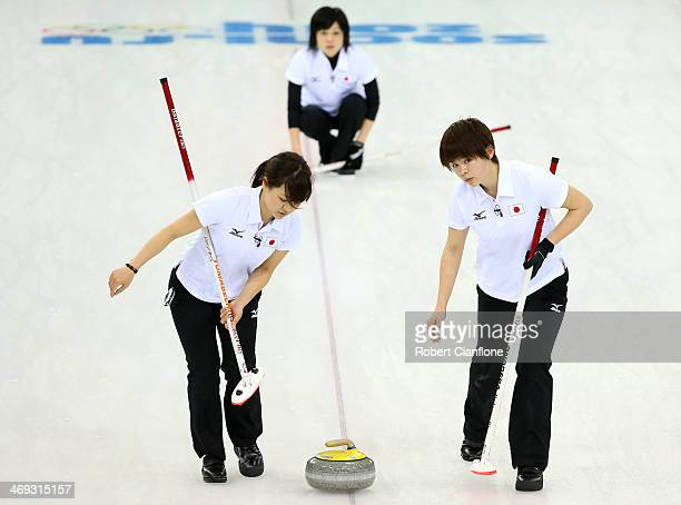 Chinami Yoshida and Yumie Funayama of Japan follow the stone during the Curling Women's Round Robin match between Japan and Great Britain on day...
