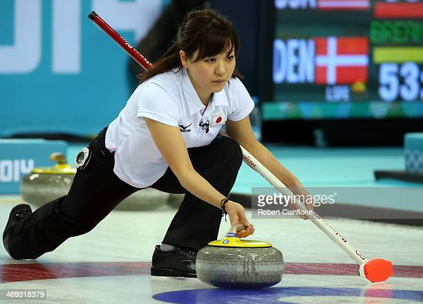 Chinami Yoshida of Japan delivers the stone during the Curling Women's Round Robin match between Japan and Great Britain on day seven of the Sochi...