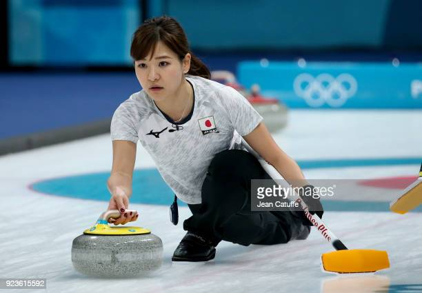Chinami Yoshida of Japan throws a stone during the women's curling semifinal game between Republic of Korea and Japan on day fourteen of the 2018...