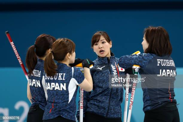 Chinami Yoshida talks to her teammates, from left, Yurika Yoshida, Yumi Suzuki, and Satsuki Fujisawa of Japan during Women's Round Robin Session 9 on...