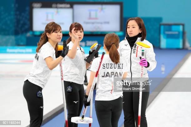 Chinami Yoshida Yurika Yoshida Yumi Suzuki and Satsuki Fujisawa of Japan high five in the 1st end during the Curling Women's Round Robin session 10...